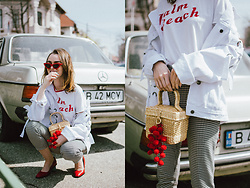 Andreea Birsan - Printed T Shirt, Gingham Trousers, Basket Bag With Pom Pom, Oversized Denim Jacket With Lace Up Details, Red Cat Eye Sunglasses, Red Leather Shoes - Spring basics