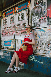 Andreea Birsan - Striped T Shirt, Red Dress, Basket Bag With Pom Pom, Small Cat Eye Sunglasses, Pearl Earrings, Sneakers - Layered dress