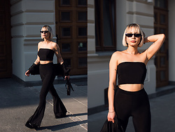 MONIKA S - Bandeau Crop Top, Flared Trousers, Leather Shoes, Sunnies, Leather Mini Purse, Cropped Bomber Jacket - IN PRIVATE