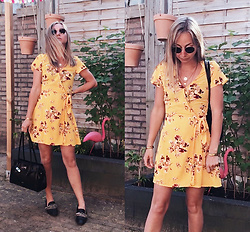 Magna G. -  - Yellow wrap dress