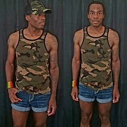 Thomas G - Csg (Champs Sports Gear) Camouflage Tank Top, Hydraulic Gramercy Authentic Vintage Denim, African Safari Imports Rasta Bracelet, Genuine Merchandise, Fan Favorite Camouflage Chicago White Sox, Contributing Writer & Photographer At Yelp, Contributing Writer At Virily - Camouflage hat & top + Cuffed denim shorts