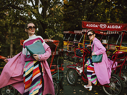 Andreea Birsan - Pink Trench Coat, Rainbow Striped Midi Skirt, Teal Hobo Bag, Stripe Sweater, Oversized Sunglasses, White Leather Pumps - Taste the rainbow