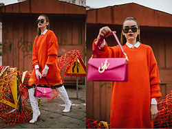 Andreea Birsan - Orange Sweater Dress, Pink Shoulder Bag, White Button Down Shirt, Oversized Sunglasses, Midi Silk Skirt, White Over The Knee Boots - Orange on orange