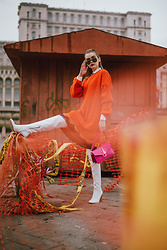 Andreea Birsan - Orange Sweater Dress, Orange Silk Lace Trim Midi Skirt, White Leather Over The Knee Boots, Pink Shoulder Bag, Oversized Sunglasses - O r a n g e