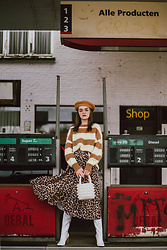 Andreea Birsan - Brown Beret, Clear Lens Aviator Glasses, Stripe Cashmere Sweater, White Beaded Bag, Pleated Midi Leopard Print Skirt, White Leather Over The Knee Boots - L e o