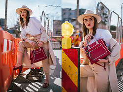 Andreea Birsan - Beige Fedora Hat, White Puff Sleeves Button Down Shirt, Beige Trousers, Beige Trench Coat, Colorblock Bag, Red Shoes - The puff sleeves shirt