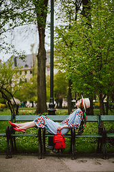 Andreea Birsan - Beige Fedora Hat, Silk Scarf, Blue Midi Embroidered Dress, Red Leather Slingback Shoes, Red Backpack - Casual day in the park