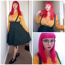 April Willis - Bottle Green Suspender Skirt, Shoe Zone Black Buckle Shoes, Primark Skin Colour Tights, H&M Mustard Floral Shirt, Sasha Round Black Glasses - Queen of Colour