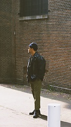 Kevin Elezaj - Dr. Martens Boots, Urban Outfitters Pants, Asos Jacket, Acne Studios Beanie - Amsterdam strolls