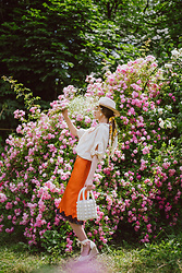 Andreea Birsan - Beige Wedges With Tie Detail, White Beaded Tote Bag, Midi Orange Silk Dress With Lace Trim, Beige Linen Button Down Shirt With Short Sleeves, Silk Scarf, Beige Fedora Hat - Orange & Beige