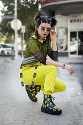 KENDALL SANCHÈZ - Mvmt Loveless Sunglasses, Fish Net Crop Top, Adidas Cross Body Bad, Prettylittlething Neon Sweat Jump Suit, Tuk Melted Smiley Face Boots - .90's Girl in the Modern World.