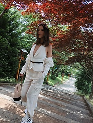 Willabelle Ong - Christian Dior Belt, Louis Vuitton Archlight Sneakers, Chanel Gabrielle Backpack, Christian Dior Solight Sunglasses - White out