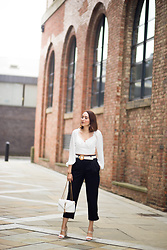 Virgit Canaz - Reiss Tapered Trousers, Shein Crop Top, Warehouse Belt, Modainpelle Block Heels - Wearing a Crop top in style