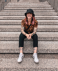 Jessie Barber - Amazon Bucket Hat, Uniqlo Ankle Length Pants, Forever 21 Leopard Print Shirt, Adidas Court Sneaker, Uniqlo Single Strap Backpack - Bucket List