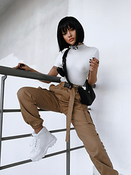 Krist Elle - Krist Elle Elle, Blogger, Kristelle Instagram, Pretty Little Thing White Slogan High Neck Short Sleeve Bodysuit, Pretty Little Thing White Flatform Sporty Chunky Trainer, Pretty Little Thing Taupe Utility Buckle Belt Joggers - Plt outfit   by krist elle