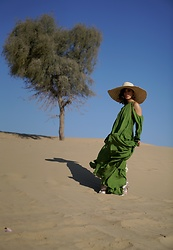 Louise Xin - Cult Gaia Green Ruffle Dress, H&M Silk Sandals, Straw Hat - Dubai desert