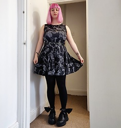 April Willis - Schuh Black Starlet Platform Trainers, Bat Wing Cuffs, Offend My Eyes Boner Skeleton Dress, Cross Waist Belt - Goth gf