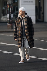 Kevin Elezaj - Converse Sneakers, Uniqlo Pants, Pangaia Sweater, Hope Coat, Asos Beanie - Yellow influence