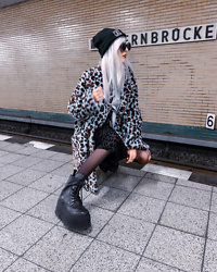 Kimi Peri - Long Clothing Logo Beanie, Witchy Symbol Glasses, Chunky Boots, Steve Madden Leopard Jacket, Motel Batis Leopard Maxi Dress - Double Leo